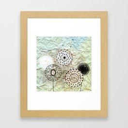 dandelions on the wrinkled paper Framed Art Print