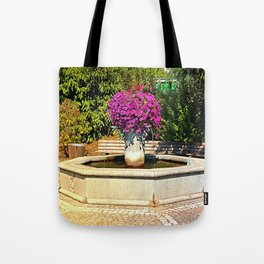 The village fountain of Eggendorf Tote Bag