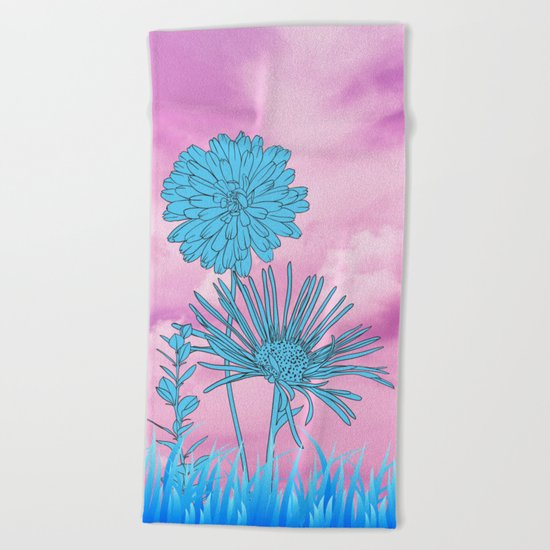 Flowers in grass Beach Towel
