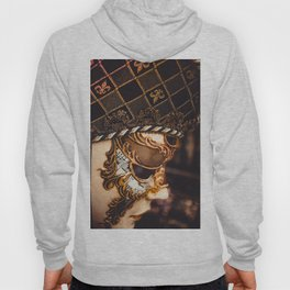 Approach of a Venetian carnival mask with its typical decorations. Hoody