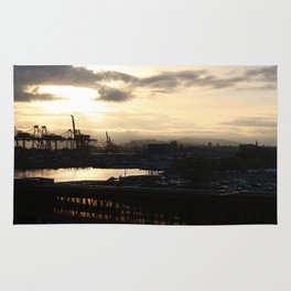 Vancouver Harbour and Seabus tunnel at sunrise Rug