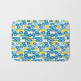 Collapsed ring pattern blue and yellow Bath Mat