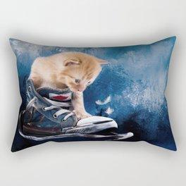 Cute kitten plays in sneakers Rectangular Pillow