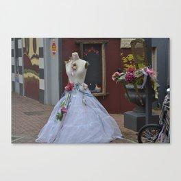 Old wedding dress on display Canvas Print