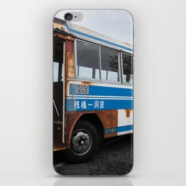 Vintage rusted bus in Japan under a dramatic sky iPhone Skin