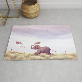 Elephant running after a kite Rug