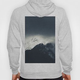 Darkness and light on snow covered mountains Hoody