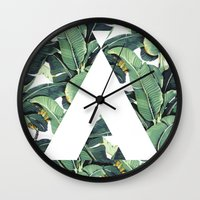 banana leaf Wall Clocks featuring Banana Leaf Love by Emily Wagner Studio