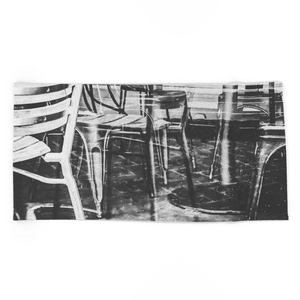 Outdoor Chairs In The City In Black And White Beach Towel by timla