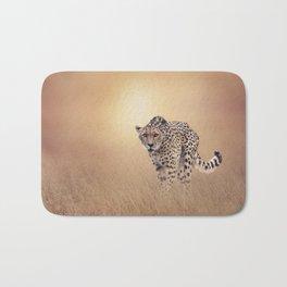 Young Cheetah walking in the grassland at sunset Bath Mat
