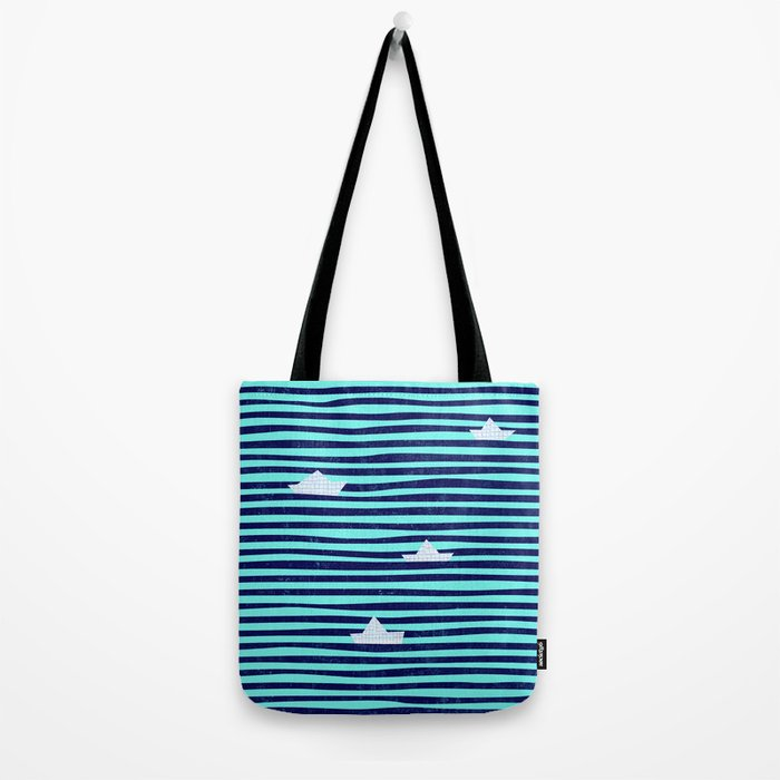 Origami boat on the blue sea Tote Bag