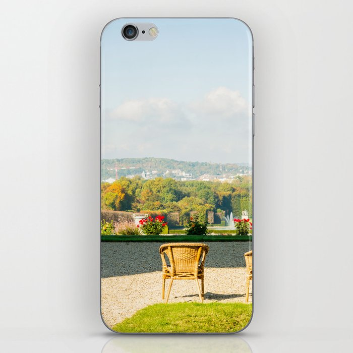 A couple of chairs on the top of a lookout watching the landscape I iPhone Skin