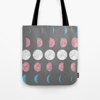moon phase Tote Bags featuring Not Just A Phase by August