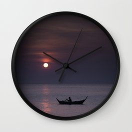 Rowing into the sunset Wall Clock
