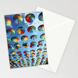 Colored umbrellas over the pedestrian street of the city. Stationery Cards