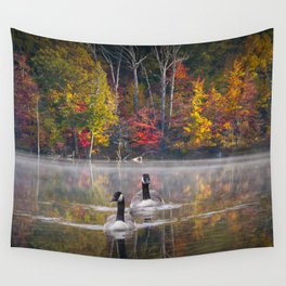 Two Canada Geese swimming in Fall Wall Tapestry