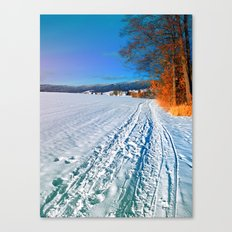 Hiking through a sunny winter scenery Canvas Print