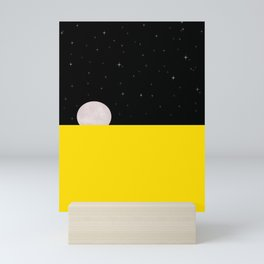 Black night with stars, moon, and yellow sea Mini Art Print