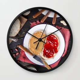 Peanut butter and jelly sandwich on a rustic table Wall Clock
