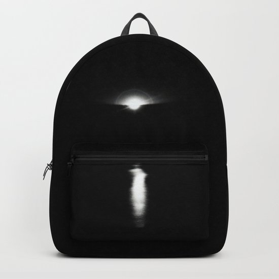Sunrise in darkness reflecting on water Backpack