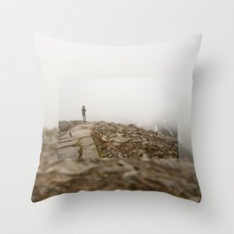 Person standing in fog on peak Throw Pillow