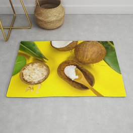 Coconut oil, tropical leaves and fresh coconuts, top view Rug