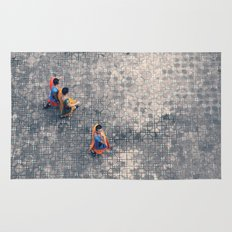 Monks in the city Rug