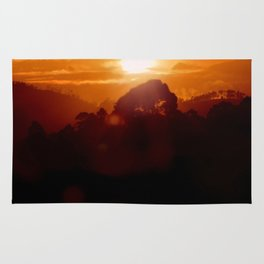 Sunset on the wild forest in the Andes Mountains Rug