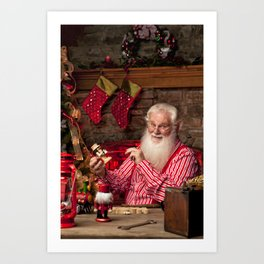 Santa Claus painting toys for Christmas Art Print