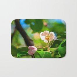 Pink crabapple flower, green leaves. Sunny day Bath Mat
