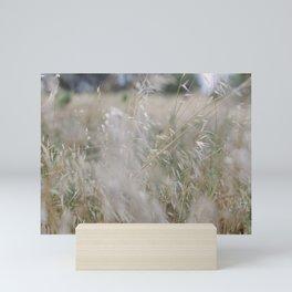 Tall wild grass growing in a meadow Mini Art Print