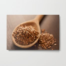 Brown flax seeds heap on wooden spoon Metal Print