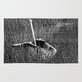 Canoe in the Reeds Rug