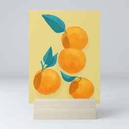 Oranges on yellow Mini Art Print