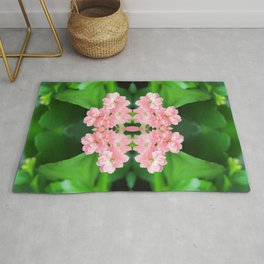 Fresh Rose Quartz color Kalanchoe flowers surreal shaped symmetrical kaleidoscope Rug