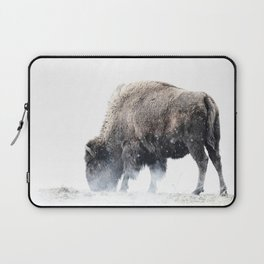 Bison grazing in a snowstorm Laptop Sleeve