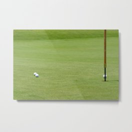 Golf balls near flagstick Metal Print
