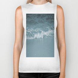 Wave splashing on a beach Biker Tank