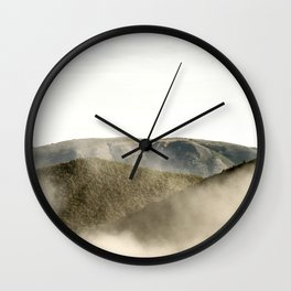 Mountains in the clouds Wall Clock