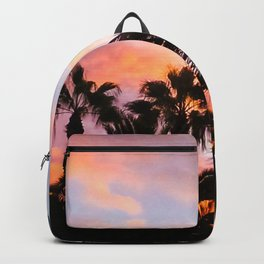 sunset and dark black palm trees Backpack
