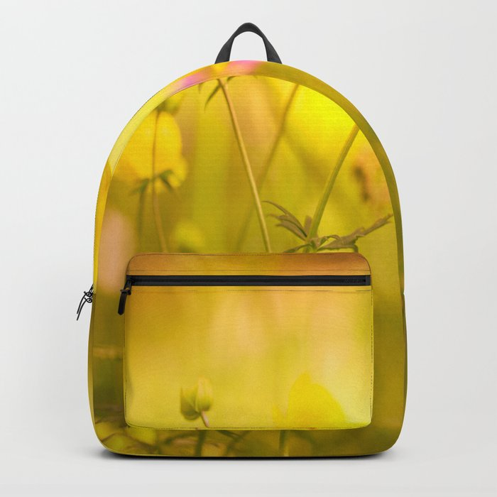 Wild flowers in the golden sunset shades Backpack