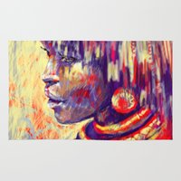 african Area & Throw Rugs featuring African portrait by Marta Zawadzka