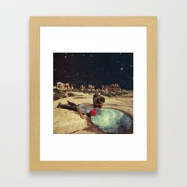 Something in the water Framed Art Print