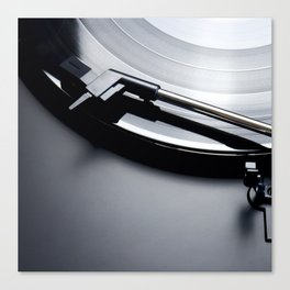 Black vinyl record spinning on a turntable Canvas Print