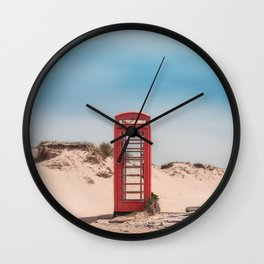 Red telephone box on a deserted beach Wall Clock
