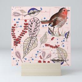 Robin with his seeds Mini Art Print