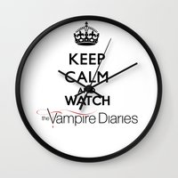 vampire diaries Wall Clocks featuring Keep Calm And Watch The Vampire Diaries by swiftstore