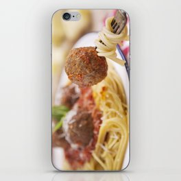 Spaghetti and meatball on a fork, plate in the background iPhone Skin
