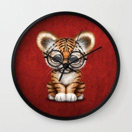 Cute Baby Tiger Cub Wearing Eye Glasses on Deep Red Wall Clock