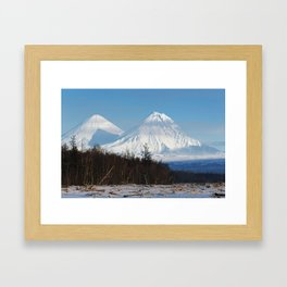 Winter scenery view of volcanoes on clear sunny day with blue sky on Kamchatka Peninsula Framed Art Print